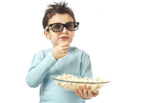 boy with popcorn and sunglasses